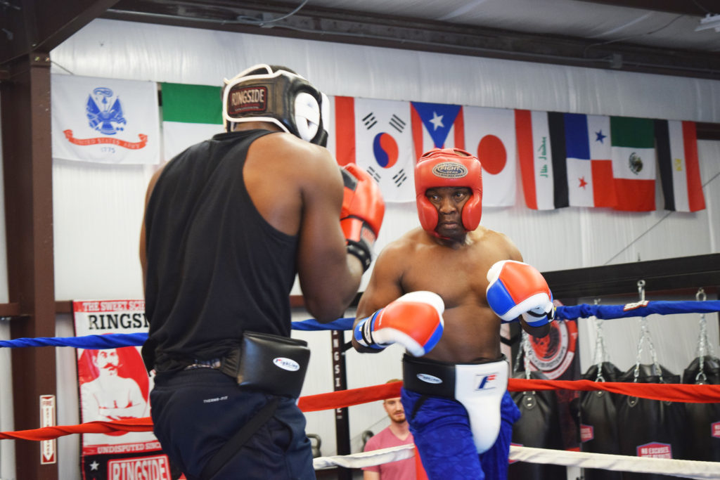 """Fulton in the ring with Sterling Gloves hopeful Jeffrey Seabury. This year's tournament is Seabury's first fight and he is """"Looking forward to knocking someone on their... """""""