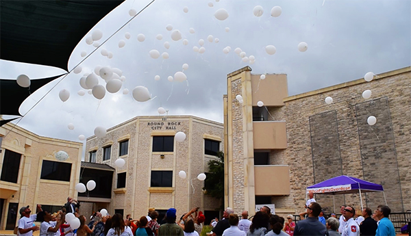 Attendees release white balloons to remember family and friends lost to or suffering from addiction.