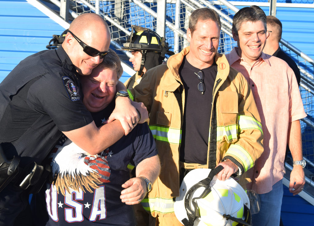 Police Chief Wayne Nero leans on Mayor Dale Ross after the long climb, with Fire Chief John Sullivan and City Manager David Morgan.