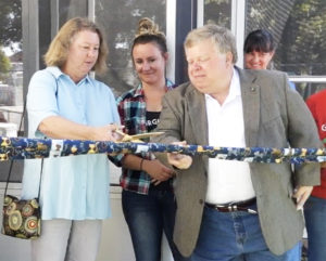 Cheryl Sedivec and Mayor Dale Ross cut the ribbon on the Georgetown Catio