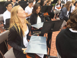 Members of the Georgetown High School orchestra keeping the rain off their instruments. The rain stopped just moments before 11am.