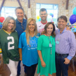 Karen (center) with some of The Locker's greatest benefactors through the years; Connie and Les Sladek, Mason Crosby, Mary and Troy Rodriguez. Mason, kicker for the Green Bay Packers, gives of his time; returning home many times each year to participate in Camp Crosby; donate NFL memorabilia and mentor and play sports with students of all ages.